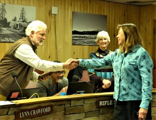 Mayor Lynn Crawford said goodbye to Debbie Goss, who is retiring from Sierra Blanca Regional Airport, as Counciilor Susan Lutterman watches.