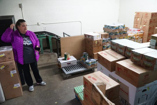 Muir Middle School cafeteria manager Kim Normandin, left, just got in this large shipment of food that she and other worker and volunteers will organize to distribute to students in need of breakfasts and lunches while school is out.