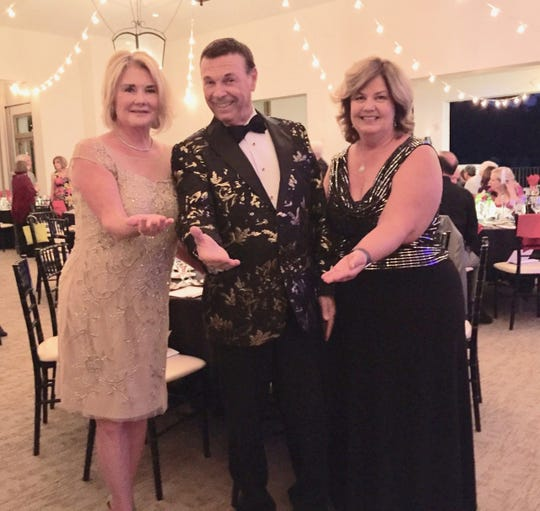 CVAP President Debbie Cox, entertainer Frank DiSalvo and benefit event chair Lisa Corcoran offer a helping hand.