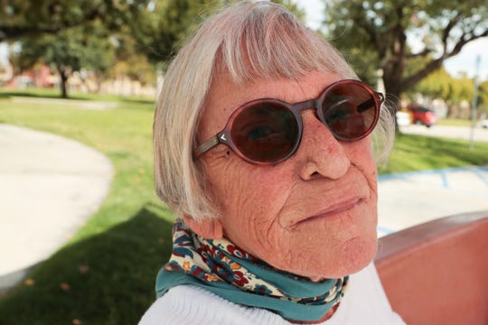 Carole Battis, 82, sits outside of the Mizell Senior Center after receiving a free take away lunch on Monday, March 16, 2020 in Palm Springs, Calif. The Palm Springs resident plans to take part in home isolation after Gov. Gavin Newsom called for California residents 65 and older to stay at home due to coronavirus.