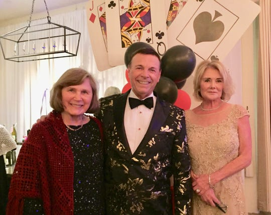 CVAP Vice President Martha McCool and President Debbie Cox pose with entertainer Frank DiSalvo.