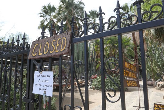 """A sign tells visitors """"We will be closed until safe to reopen"""" at Moorten Botanical Garden in Palm Springs, March 16, 2020."""