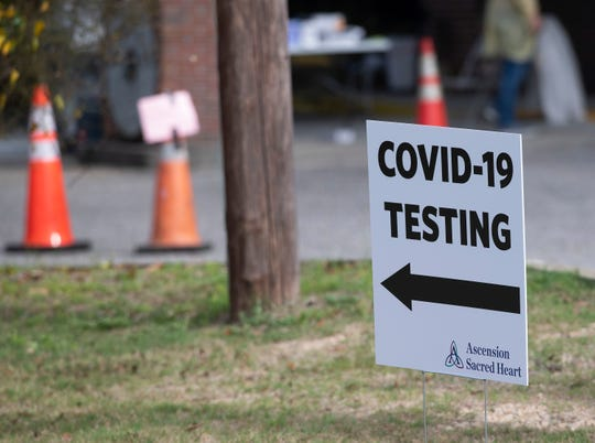Ascension Sacred Heart medical professionals set-up and operate a drive-through test site for the COVID-19 virus on Monday, March 16, 2020.