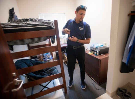 University of West Florida student Kyle Lowery returns to a near-empty on-campus housing complex on Monday, March 16, 2020.