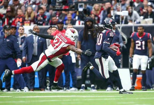 Houston Texans wide receiver DeAndre Hopkins (10) runs with the ball as Arizona Cardinals cornerback Patrick Peterson (21) defends during the third quarter at NRG Stadium in a 2017 game. Hopkins has reportedly been traded to the Cardinals.