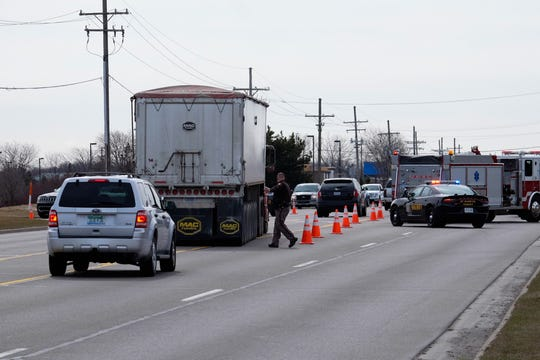 Traffic is diverted around a crash on 24th Avenue in Fort Gratiot Monday.