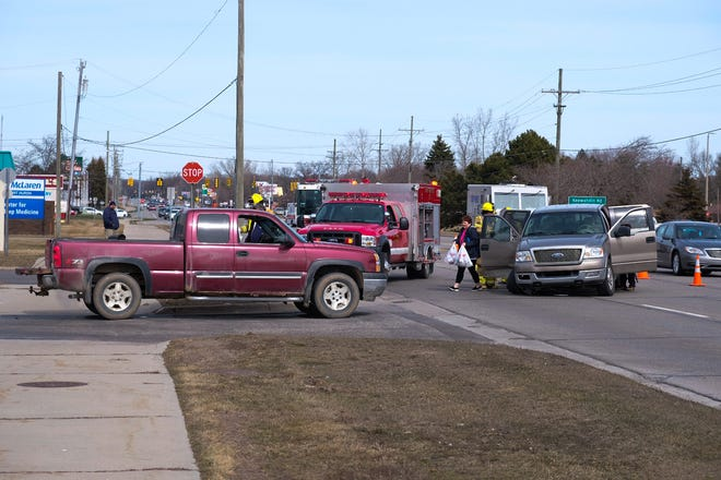 Rescue crews respond to a crash Monday afternoon on 24th Avenue in Fort Gratiot.