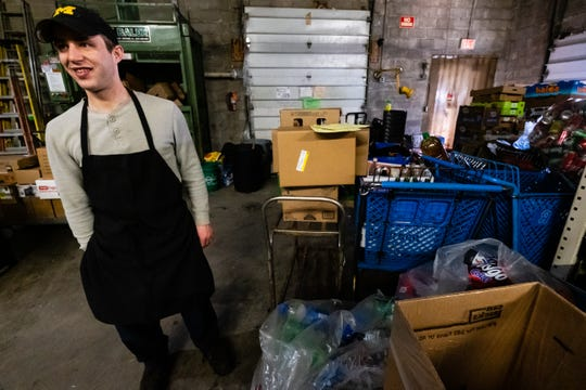 Bradley Distelrath works on unpacking inventory in the back of Wally's Supermarket Friday, March 13, 2020. Distelrath said he's noticed more people coming to the store after larger stores, like Meijer or Walmart, run out of staple items.