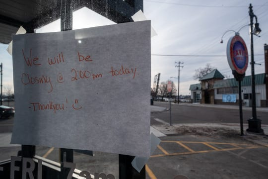 A hand-written sign taped to the door of Cavis Grill in downtown Port Huron announces that the restaurant will be closing early Monday, March 16, 2020. Gov. Gretchen Whitmer ordered all restaurants and bars to close at 3 p.m. Monday.