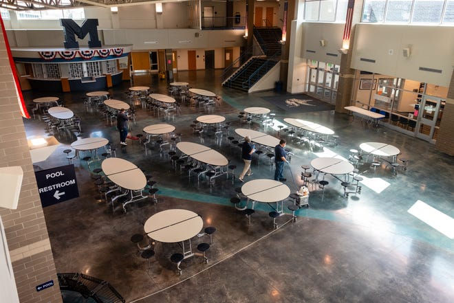 Janitorial and maintenance workers work to clean the cafeteria at Marysville High School after lunch period Friday, March 13, 2020. On March 12, Gov. Gretchen Whitmer ordered all K-12 schools in Michigan be closed starting Monday, and to remain closed through April 5.