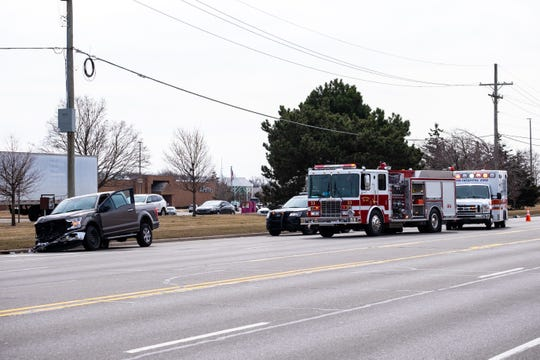 Rescue crews respond to a crash on 24th Avenue Monday, March 16, 2020, in Fort Gratiot. A deputy on the scene said the driver of a tan Ford pickup was suffering from a medical condition when he started driving erratically.