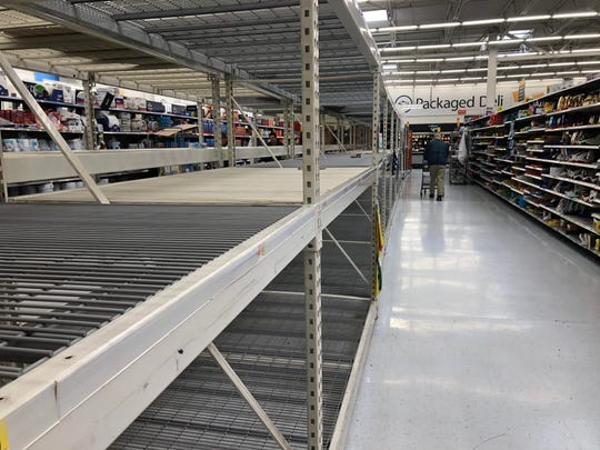 Empty shelves where toilet paper typically goes at a Walmart in West Manchester Township.