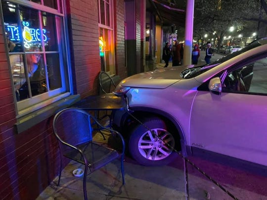 A car crashed into some tables and chairs at the Holy Hound Taproom, located at 57 West Market Street. Photo Credit: Joe Canganelli
