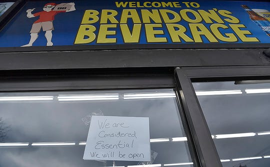 """Brandon's Beverage on Mt. Rose Avenue has a sign on the door stating they are """"essential"""" and will stay open during the governor's two-week shutdown, Monday, March 16, 2020. John A. Pavoncello photo"""