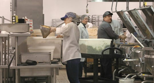 Foodlink staff work to prepare thousands of meals at Foodlink on Mt. Read Blvd. in Rochester Monday, March 16, 2020. Foodlink will prepare over 20,000 meals this week, above what they are already preparing for other food programs in the area. In response to Rochester city schools closing due to the coronavirus, Foodlink is helping provide some meals to nine recreation Centers and seven schools for their grab-and-go distributions.