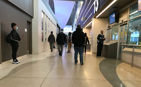 The Transit Center has a light but steady passengers during the morning commuters on Monday, March 16, 2020.  In the last few days more and more people have been wearing gloves or face masks due to Covid-19.