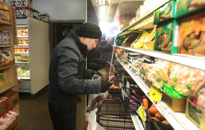Joe Zou of Webster shops at Canton supermarket.