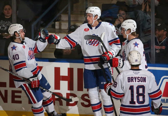 Rochester's Tage Thompson, center, celebrates his goal in the second period with teammates Remi Elie, left, Casey Nelson, right, and Jacob Bryson during the Americans' season opener Friday, Oct. 4, 2019 at Blue Cross Arena. The American Hockey League season has been suspended indefinitely and will not resume until at least May,