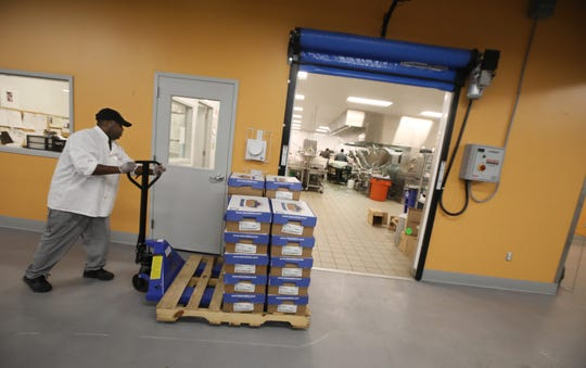 Foodlink staff work to prepare thousands of meals at Foodlink on Mt. Read Blvd. in Rochester Monday, March 16, 2020. Foodlink will prepare over 20,000 meals this week, above what they are already preparing for other food programs in the area. In response to Rochester city schools closing due to the coronavirus, Foodlink is helping provide some meals to 9 R-Centers and 7 schools for their grab-and-go distributions.