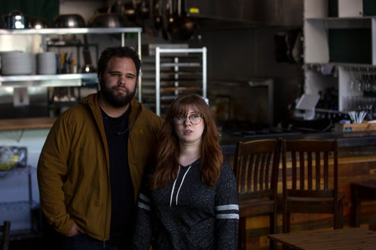 """Owners Jonathan Jones and Maura Ryan pose for a portrait at their restaurant, Epilogue Kitchen & Cocktails, on March 16, 2020. The couple announced the closure as an """"ethical decision"""" to protect the community."""
