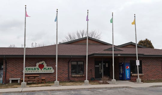 The exterior of Child's Play Learning Center as seen, Monday, March 16, 2020, in Sheboygan, Wis.  Several day cares in the area remain open as some parents do not have work from home options due to the coronavirus situation.