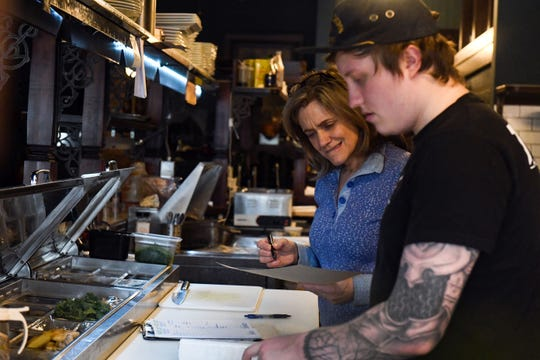 Stacy Newcomb Weiland and Landon Schumacher go over the night's menu on Monday, March 16, at Parker's Bistro in Sioux Falls.