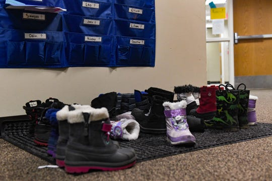 Children's snow boots sit left behind at EmBe, where daycare facilities are closed for several days due to concerns with the coronavirus on Monday, March 16, in Sioux Falls.