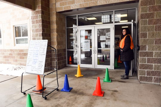 Laura Siebenborn, administrator intern, greets students and their parents when they arrive to receive breakfast and lunch packages while school is out of session due to concerns about the coronavirus on Monday, March 16, at Terry Redlin Elementary in Sioux Falls.