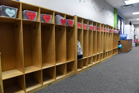 Children's cubbies stand empty at EmBe, where daycare facilities are closed for several days due to concerns with the coronavirus on Monday, March 16, in Sioux Falls.