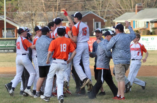 Grace Christian players and coaches celebrate Peter Shifflett's perfect game Friday afternoon.