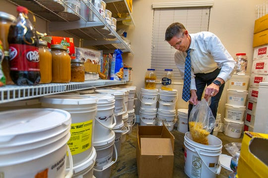 Cory Steed restocks macaroni as part of the food items stored in their home pantry on Monday, March 2, 2020 in Las Vegas. The Steeds are members of the Church of Jesus Christ of Latter-day Saints and follow its recommendations to maintain a supply of food, water and other provisions for use in an emergency.(L.E. Baskow/Las Vegas Review-Journal via AP)