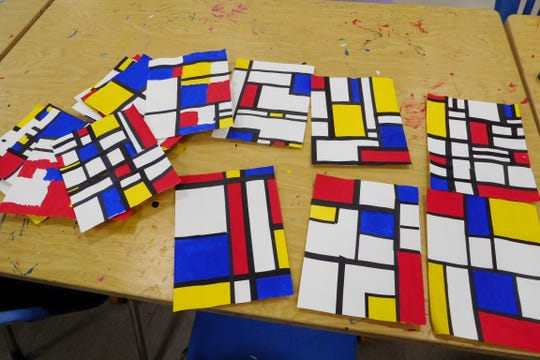 Students practiced fractions by creating artworks inspired by Mondrian's Composition II with Red, Blue and Yellow.