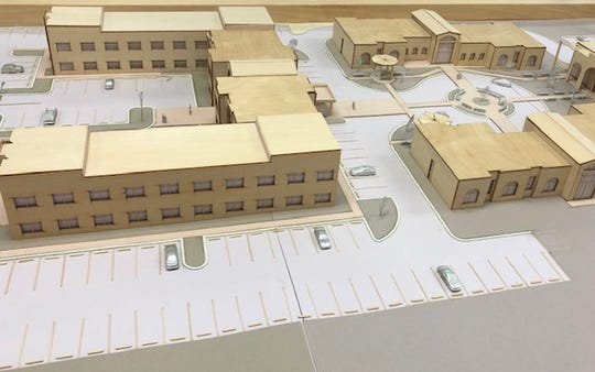 A wooden diorama prepared for the Dynamic Life Recovery Center was shown to behavioral health specialists to keep them an idea what a campus for mental health services in Indian River County could look like in the future.