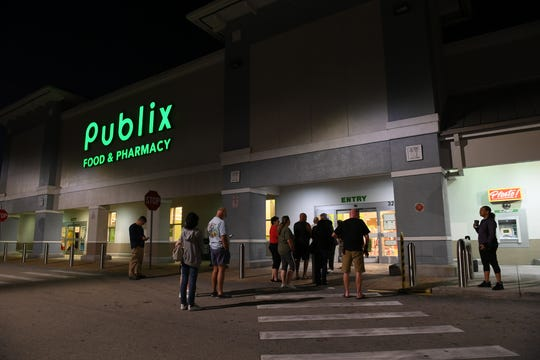 """About a dozen shoppers were outside Publix at Darwin Square Monday, March 16, 2020, in Port St. Lucie. Robert Shottland, the first in line, arriving at 6 a.m., but came out of the store empty-handed. """"I was the first one in there but there's nothing in there,"""" Shottland said. """"I see people starting to panic and I guess everybody wanted water and paper towels and they just can't get any. I see people being very frustrated."""""""
