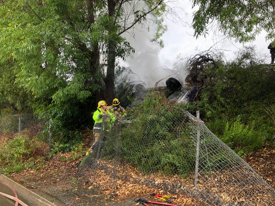 Firefighters with Ventura County Fire helped put out a fire after a vehicle crash in Santa Paula Monday morning.