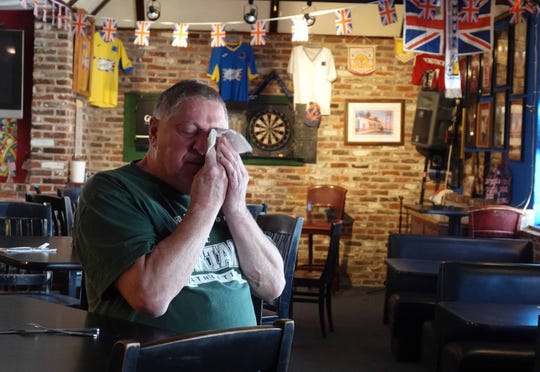 "Mike Stone, owner of Stoney's British Pub for over 20 years, wipes away tears while talking about making the decision to temporarily closed his pub for at least two weeks. He fears he might lose his business.  Stone said he'd""rather be cautious than sorry. ""I know some don't believe how serious what's going on is, but, to be honest, I'm scared. People can literally die,"" he said."