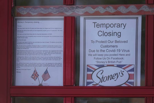 A sign and letter hangs on the door of Stoney's Pub on Rt. 202 letting customers know they are closing for the time being because of the coronavirus (Covid-19 virus).