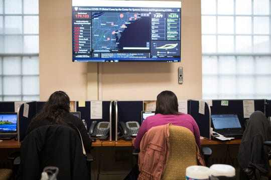 Scenes from inside the call center at the State Health Operations Center in Smyrna. The center is the state's primary location for planning and operations to prevent the spreading of the coronavirus in Delaware.