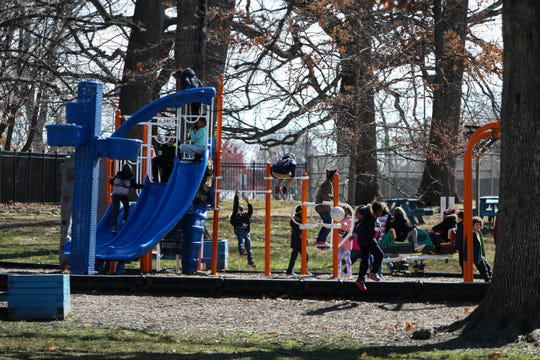 Kids crowd onto the playground at the Boys & Girls Club in Wilmington on Monday. Some community centers have closed due to safety concerns due to the spread of coronavirus, but others stay open in an attempt to continue important services.