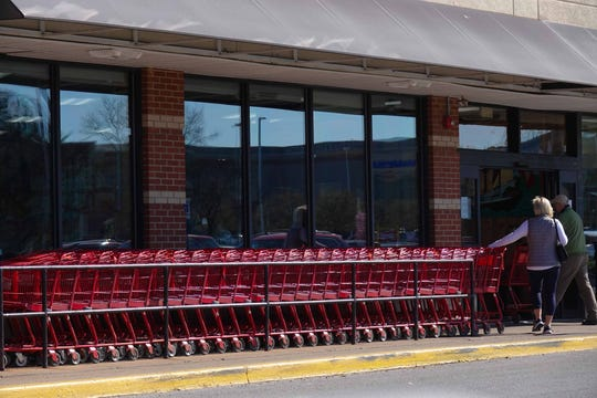 Shoppers grab grocery carts at Trader Joe's on Rt. 202 Monday morning. Shelves were restocked with food. Toilet paper was available but limited to one pack per customer.