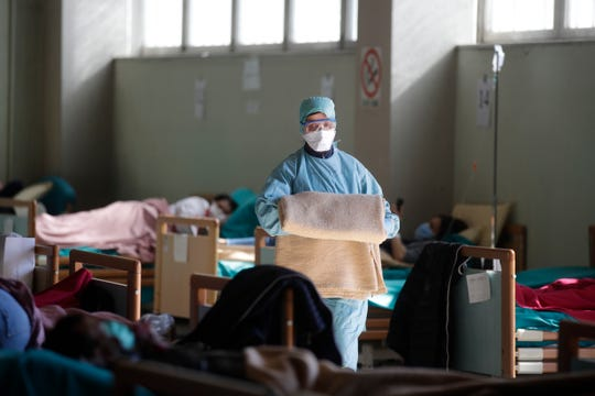 Medical staff work at one of the emergency structures set up at the Brescia hospital in northern Italy.