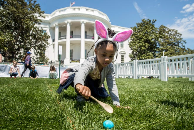 Chloebella Frazier, 4, of Washington, takes part in the annual White House Easter Egg Roll on the South Lawn of the White House on April 22, 2019.