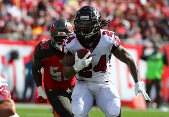 Atlanta Falcons running back Devonta Freeman (24) runs with the ball against the Tampa Bay Buccaneers during the first quarter at Raymond James Stadium.
