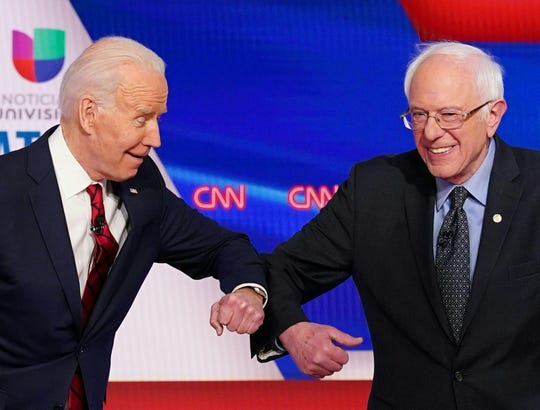 In what may be the final debate of the Democratic primary for 2020 election cycle, Joe Biden and Bernie Sanders bump elbows before facing off in a CNN television studio on March 15.