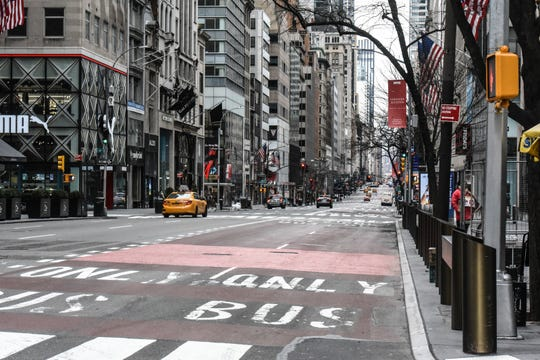 Fifth Avenue in Midtown Manhattan is mostly clear of traffic on March 15, 2020 in New York City.