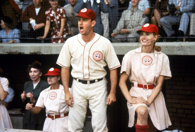 "Tom Hanks stars as the alcoholic coach of a team of female baseball players (including Geena Davis) in ""A League of Their Own."""