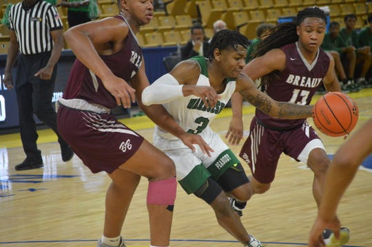 Peabody's Melvion Flanagan (3) tries to dribble against Breaux Bridge during the Class 4A championship game Saturday.