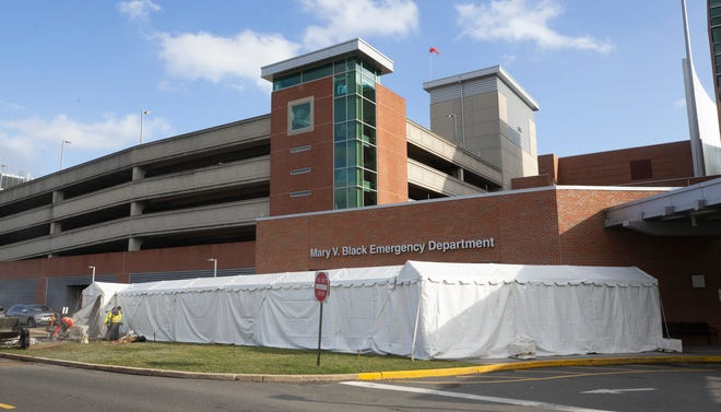 A temporary tent is assembled outside the Mary V. Black Emergency Department of the Jersey Shore University Medical Center in Neptune, NJ on March 17, 2020.