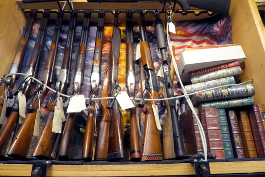 A display case of rifles for sale at Guns & Roses in Toms River Tuesday afternoon, March 17, 2020.  In the wake of the coronavirus pandemic, there has been sky-high demand for guns and ammunition.