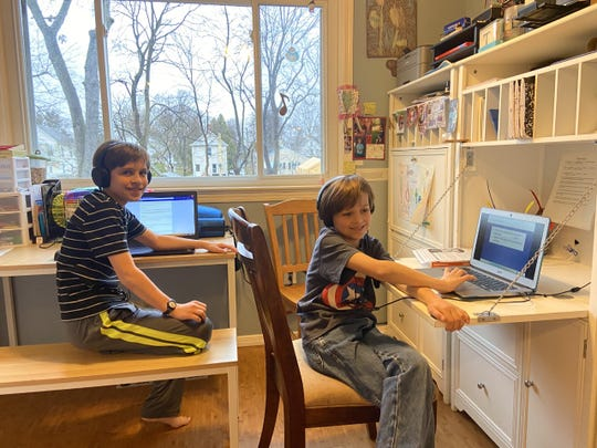 David and Jonathan Goetke work on virtual school lessons in their Freehold Borough home.